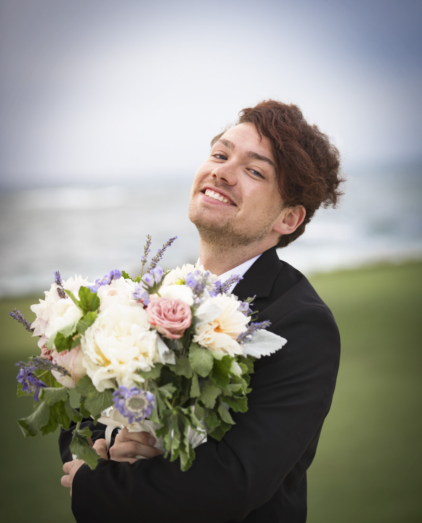 Intern Colby with flowers at wedding